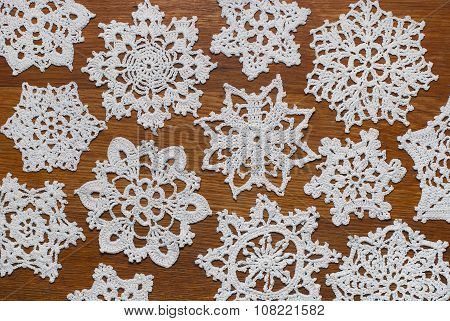 Crocheted Snowflakes  On A Wooden Background