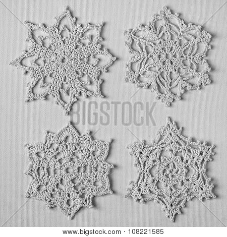 Crocheted snowflakes on canvas