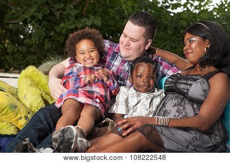 Multicultural Family On The Couch