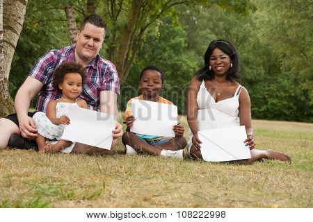 Multicultural Family With Blank Boards