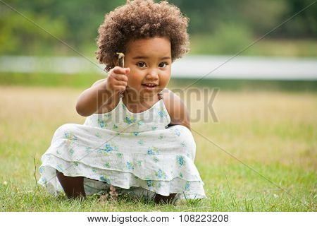 African Girl With A Flower