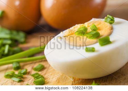 Half Of Boiled Egg  Prepared On Cutting Board