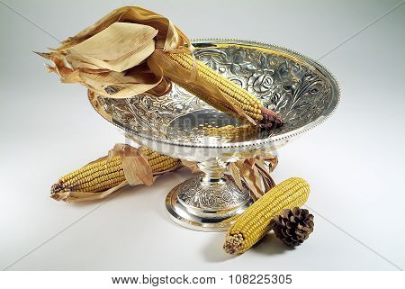 Silver Vase With Corn Cobs