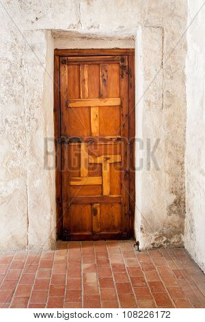 Wooden Door against Whitewashed Plaster Wall