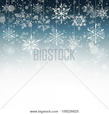 Winter background with snowflakes fading into white, vector illustration