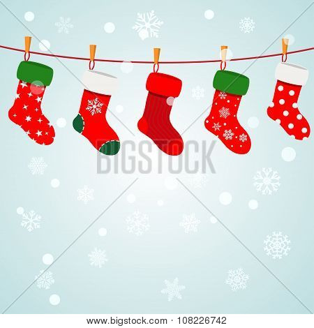Christmas Background With Socks Hanging On A Rope