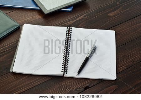 Open Notepad Closeup On Wooden Office Table
