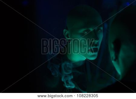 Club Party - Nightlife. Handsome Sexy Young Stylish Man Smoking In Nightclub