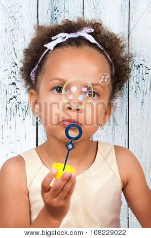 Close-up Portrait African  Girl Blowing Soap Bubbles
