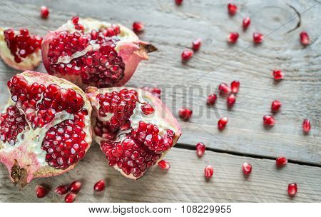 Pomegranate On The Wooden Background