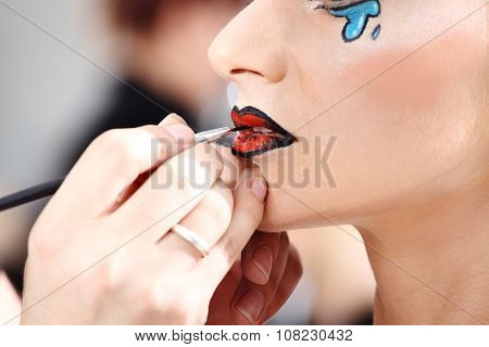 Makeup Artist Applying Lipstick On Model Lips With Brush, Closeup