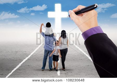 Hand Guiding A Family To The Cross