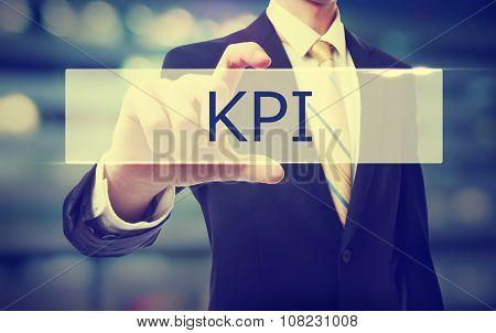 Business Man Holding Kpi