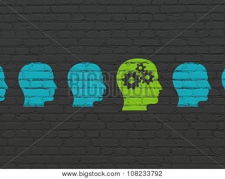 Finance concept: head with gears icon on wall background