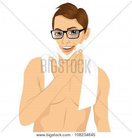 young man applying shaving cream foam