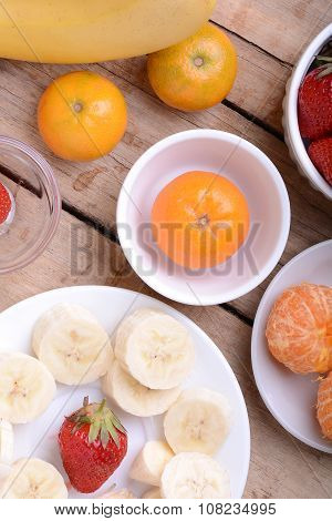 Fresh Colorful Fruits Composition Mandarin, Strawberry, Peach, Bananas And Orange