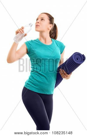 Beautiful Young Girl Holding Excercise Mat, Drinking Water