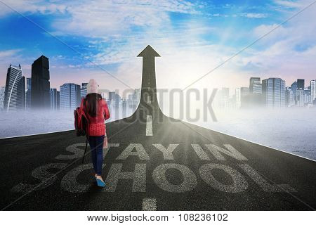 Student Wearing Sweater And Walking On Highway