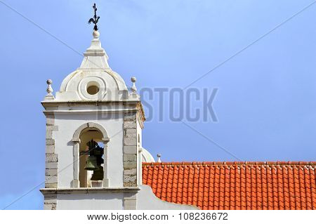 The historical Santa Maria Church bell tower in Lagos