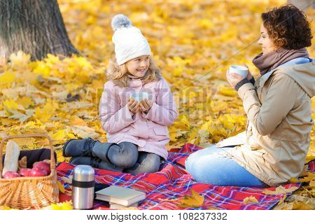 Content mother and daughter having lunch