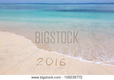 Year 2016 on sandy beach