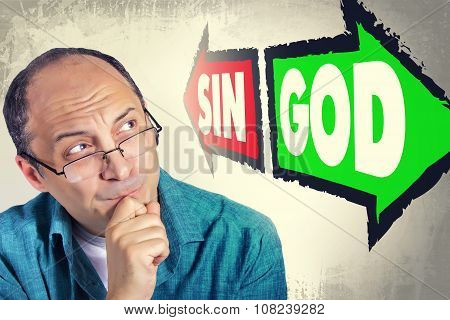 Portrait Of Adult Man Faced With Choice Between Sin And God