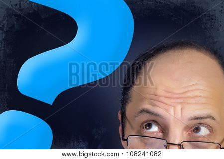 Man Looking To Big Question Mark