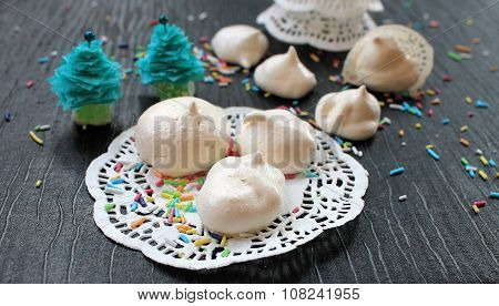 Meringue cakes out of the egg white and sugar white lacy napkin in the New Year an