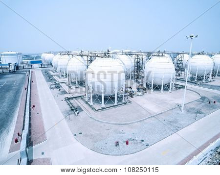 view of oil depot with containers in blue sky