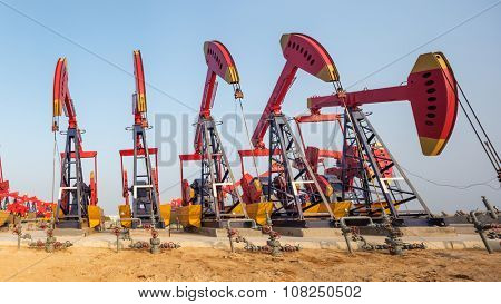 landscape of oilfield with pump units working  in blue sky