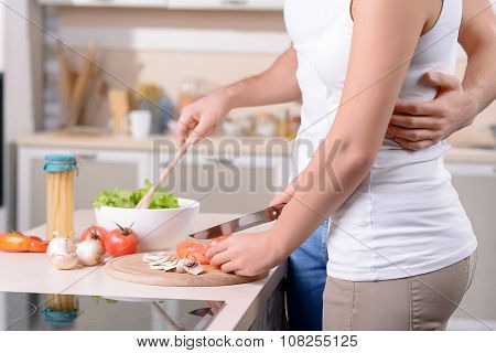 Content loving couple having fun in the kitchen
