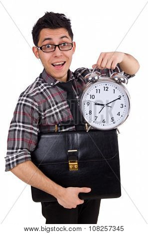 Young employee with backpack and alarm clock isolated on white