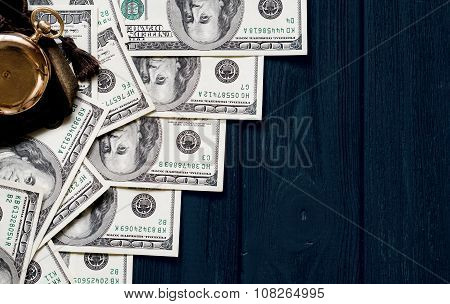 Stack Of Money Dollars Laid Out Like A Ladder With Antique Gold Watch On Dark Blue Retro Stylized Wo
