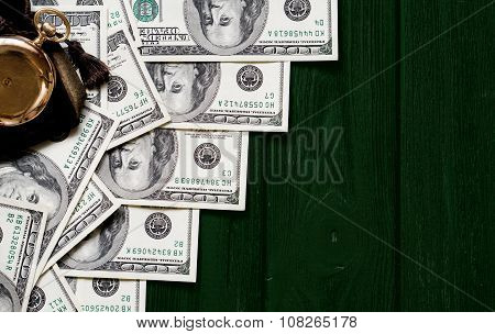 Stack Of Money Dollars Laid Out Like A Ladder With Antique Gold Watch On Dark Green Retro Stylized W