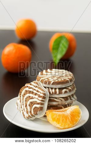 Sweet sour peeled tangerine orange and leaf and cocoa cookies on plate