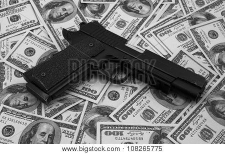 Black And Chrome Gun Pistol And Money Dollars Background Black And White