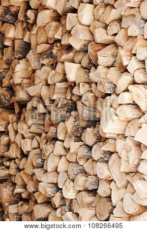 Dry Chopped Firewood Logs In A Pile.