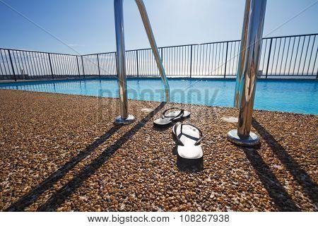Flip Flops At A Pool Edge Nobody
