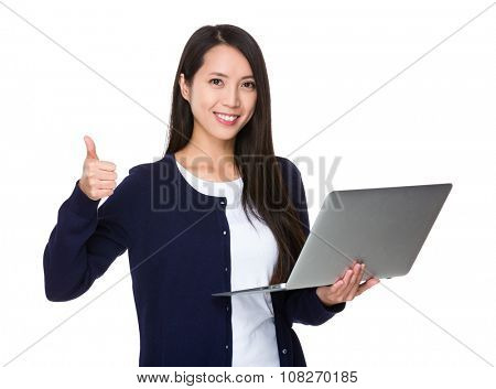 Asian Woman use of the portable computer and thumb up