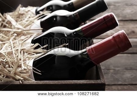 Wine bottles in wooden crate,  black and white retro stylization