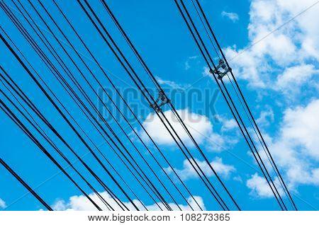 High Voltage Transmission Lines On Blue Sky