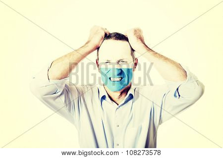 Mature man with San Marino flag painted on face.