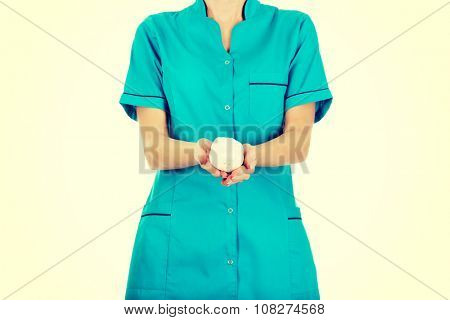 Doctor woman holding a bandage.