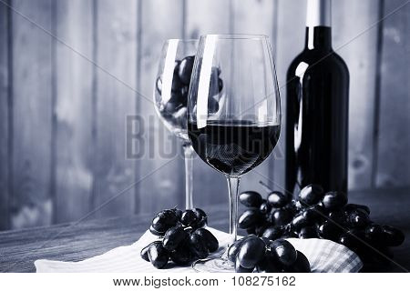 Beautiful still life with wine and grape,  black and white retro stylization