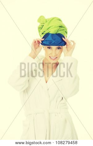 Woman in bathrobe with sleep bandage.