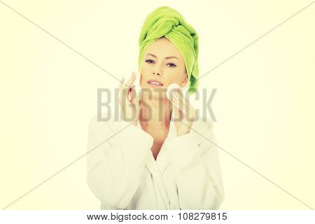 Beautiful caucasian woman with cotton pad.