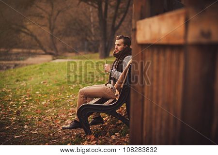 Man Sitting Alone On A Bench