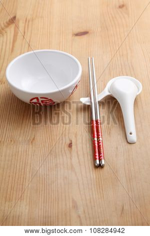 empty chinese rice bowl with spoon and chopsticks
