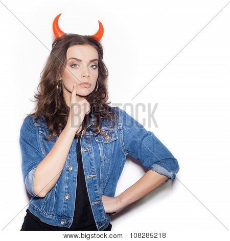 Close Up Of  Cute Brunette With Red Horns Like Devil