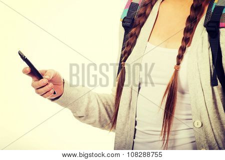 School girl texting to someone.